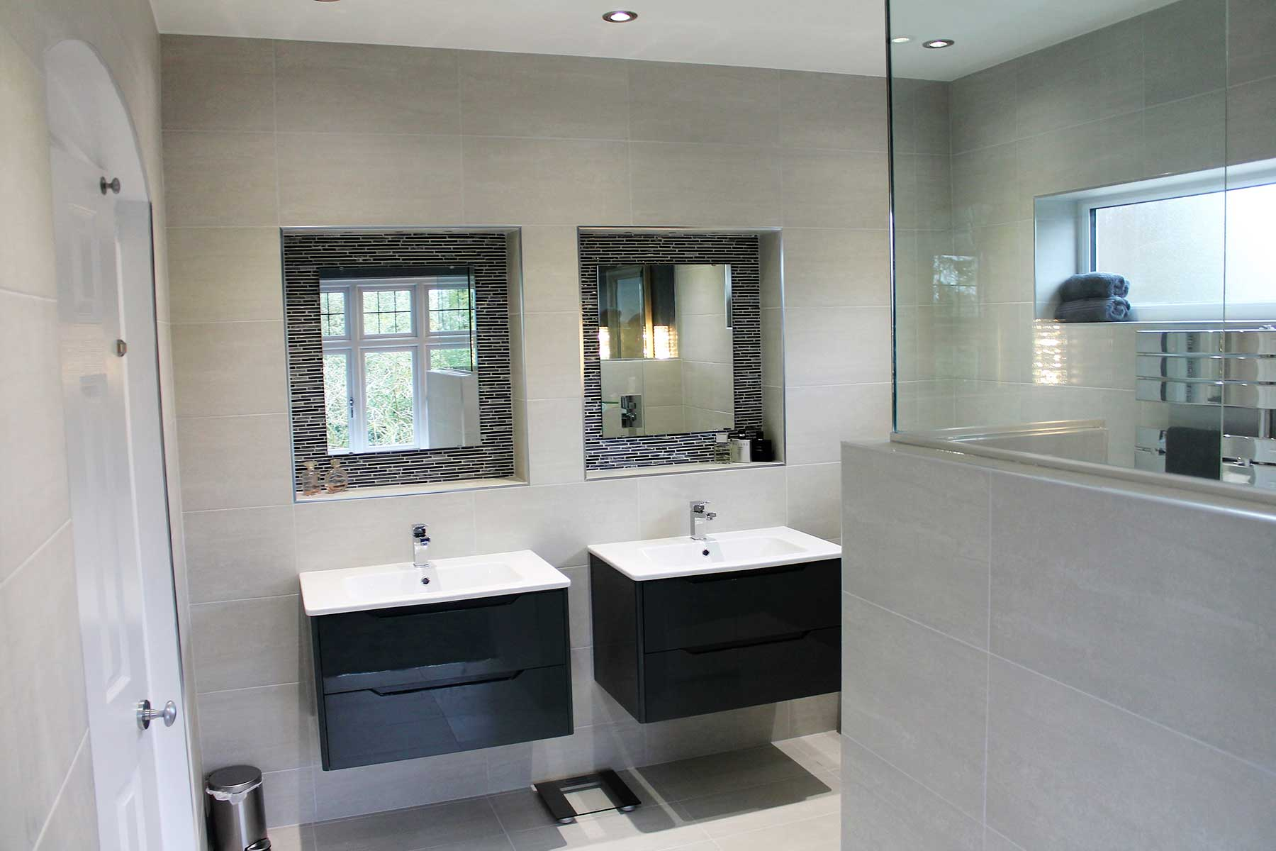 Contemporary grey wet room with integrated dressing area