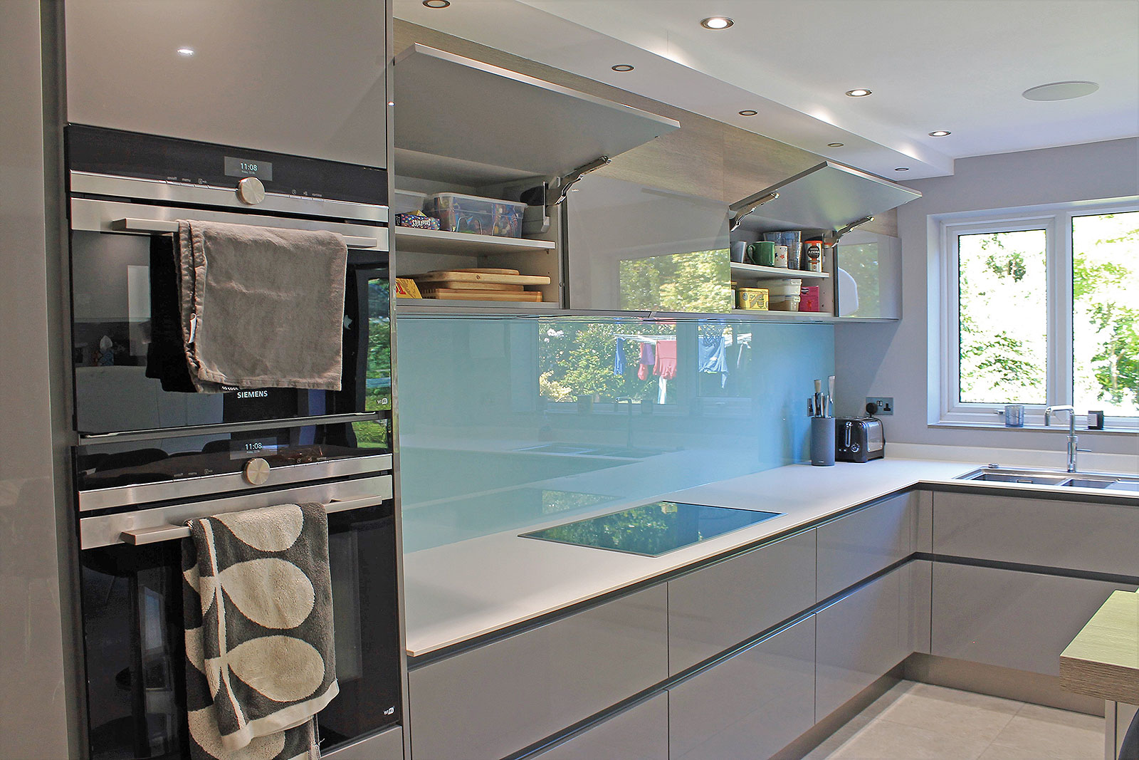White Modern German Kitchen with White Corian® Work Surfaces ...